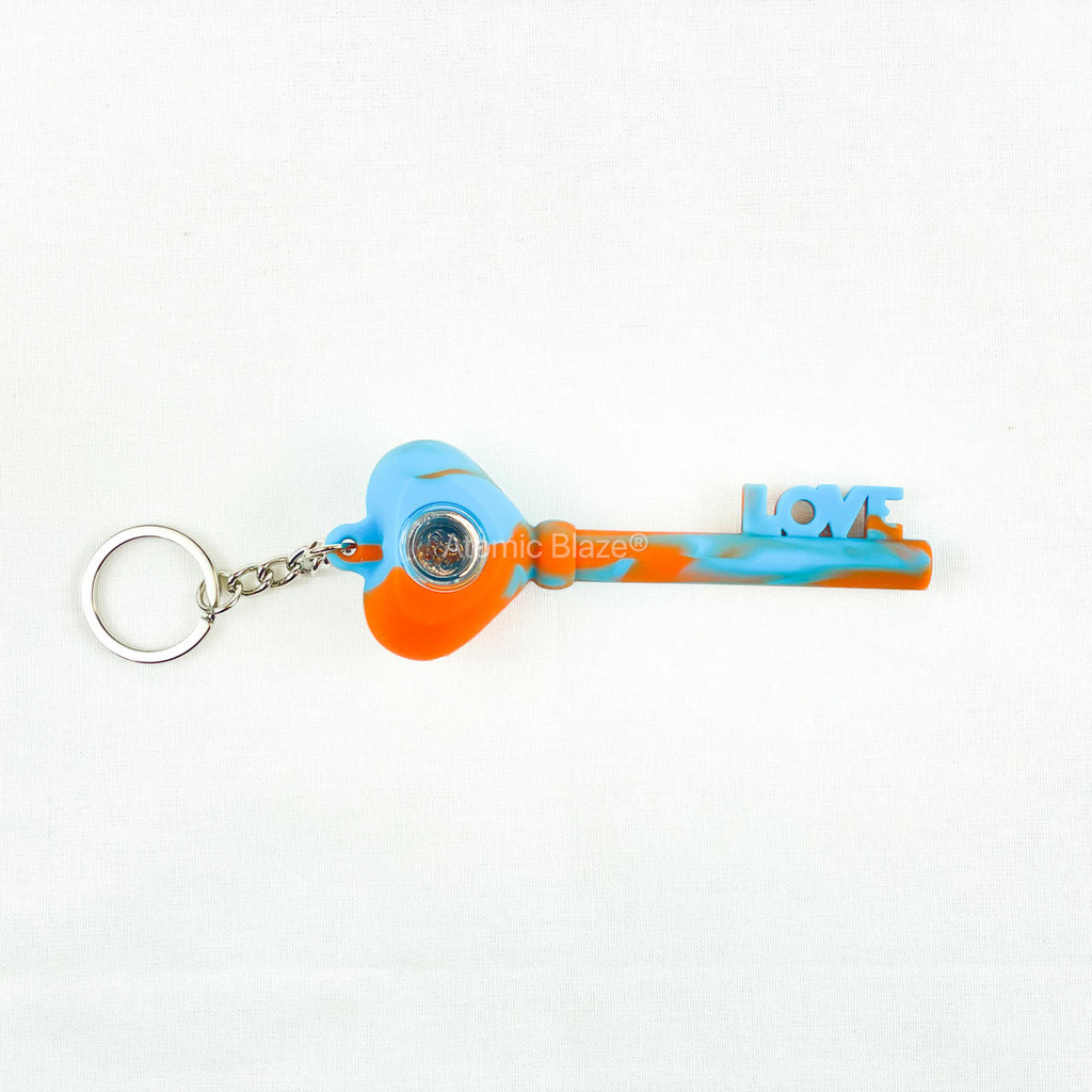 Sale on a Key of Love Keychain Pipe from Atomic Blaze Headshop in orange and blue and we always have the cheapest glass pipes and bongs and free shipping promos