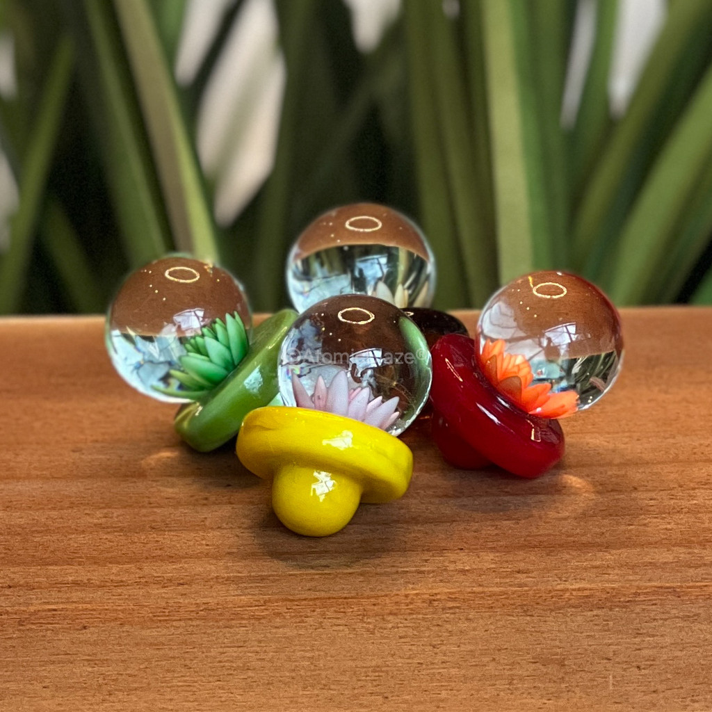 Buy a glass flower carb cap in a variety of colors from Atomic Blaze Online Smoke Shop.