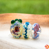 This triple blown glass pipe has your back: it's solid, sturdy and has perfectly placed glass knobs for grip.