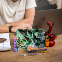 The small leaf metal tray is large enough to hold your handheld smoke pieces and ground tobacco, exclusively from Atomic Blaze Online Smokeshop.