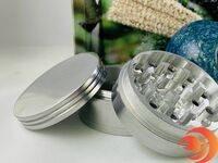 This three chambered large metal grinder is an essential smoke accessory in the Atomic Blaze smoke shop online.