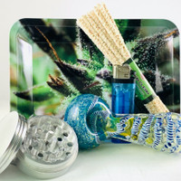 The Premium Smokers Gift Bundle includes a triple blown glass smoke pipe, metal grinder, a rolling tray, hard bristle pipe cleaners and more.