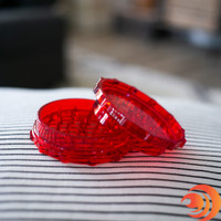 This large red plastic grinder from our online smoke shop will shred your tobacco as fine as you need from Atomic Blaze Headshop Online.