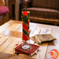 Here's a rasta-colored silicone wrapped straight tube glass bong for ultimate portability from AtomicBlaze Smoke Shop.