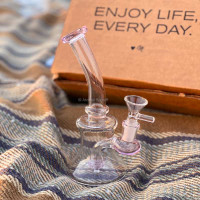 This Glass Dab Rig by Atomic Blaze Online Smoke Shop is equipped with a glass bowl and a removable 14mm quartz banger