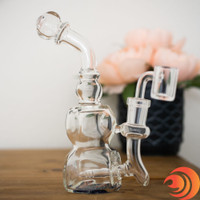 This crystal clear glass dab rig comes with a quartz banger, and it's great for novice smokers available with free shipping at Atomic Blaze Smoke Shop.