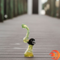 Here's a 9 inch glass bubbler with yellow swirls and a black bowl available from Atomic Blaze online head shop in Sarasota, FL