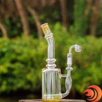You can see the yellow tinted fluted mouthpiece and base on this glass dab rig from the best online smoke shop in Sarasota, FL