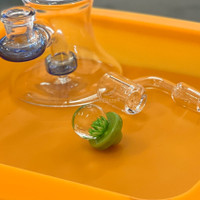 Purchase a green glass flower carb cap from Atomic Blaze Online Smoke Shop.