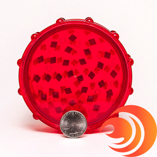 This big red plastic grinder is easy to use and is a quality acrylic herb crusher