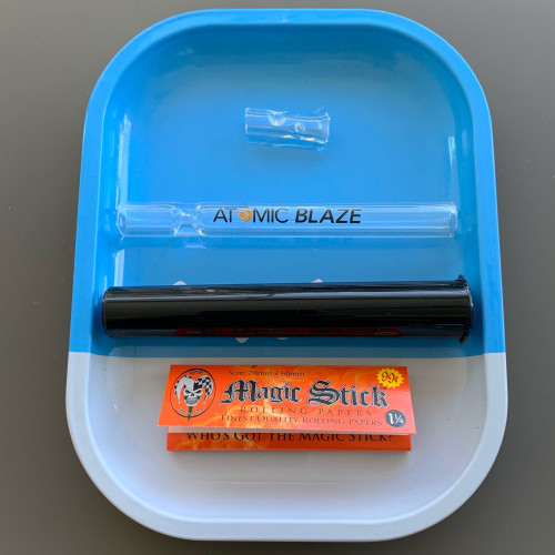 The Smokers Essentials Bundle includes a rolling tray, glass chillum, doob tube, rolling papers and a glass filter tip.