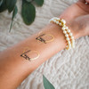 Sparkle in the romantic inspired 'LOVE NOTES' metallic gold and black ink party tat! @FlashTattoos #FUNTATS