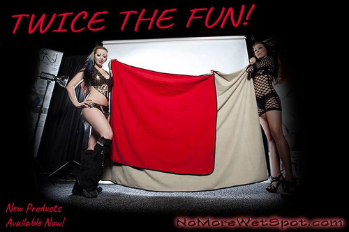 The girls are holding up the jumbo, along with one of our regular Red/Black blankets.