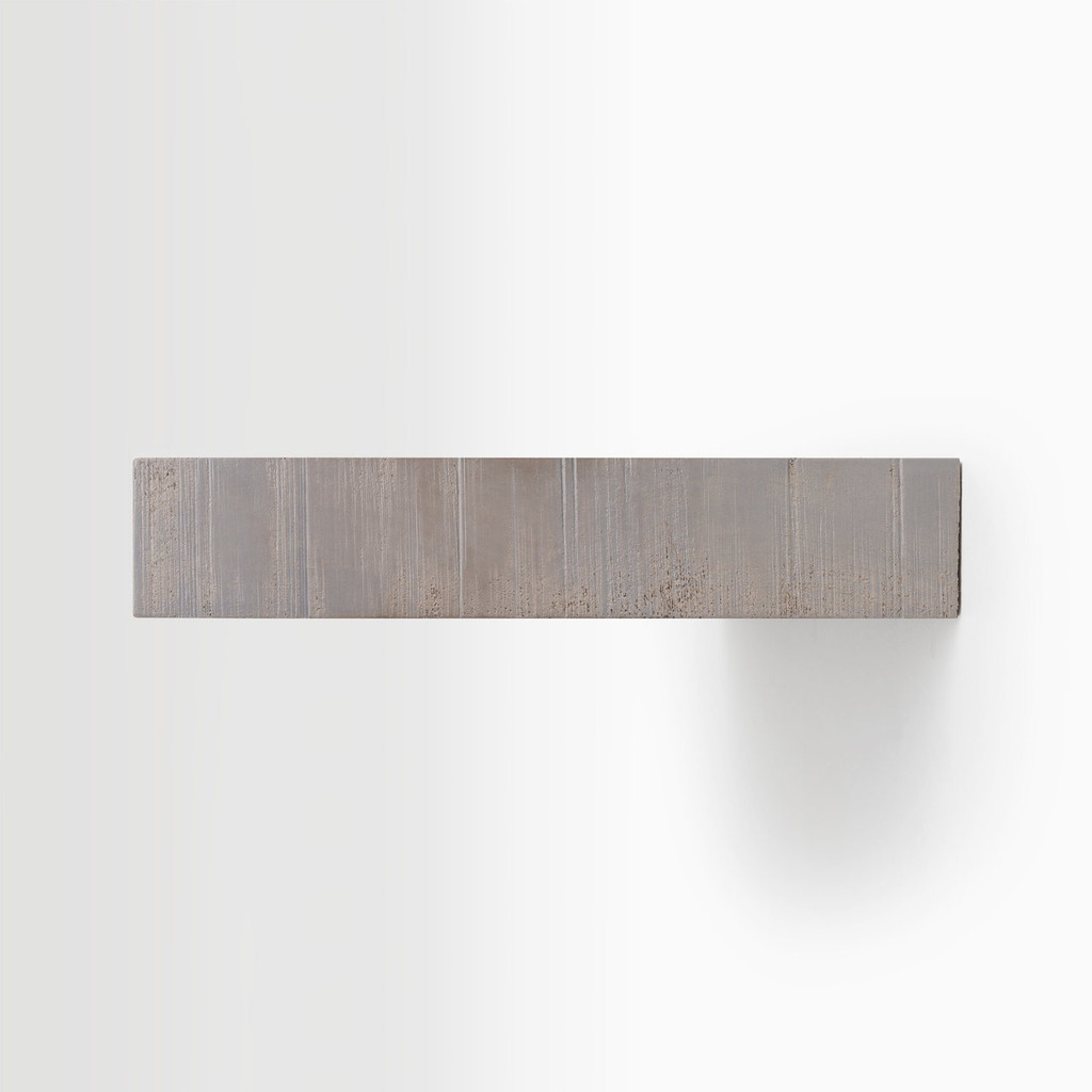 Side edge of our rough cut hatch grey floating wood shelves. The hardware is easy to install on most wall treatments and is completely invisible.