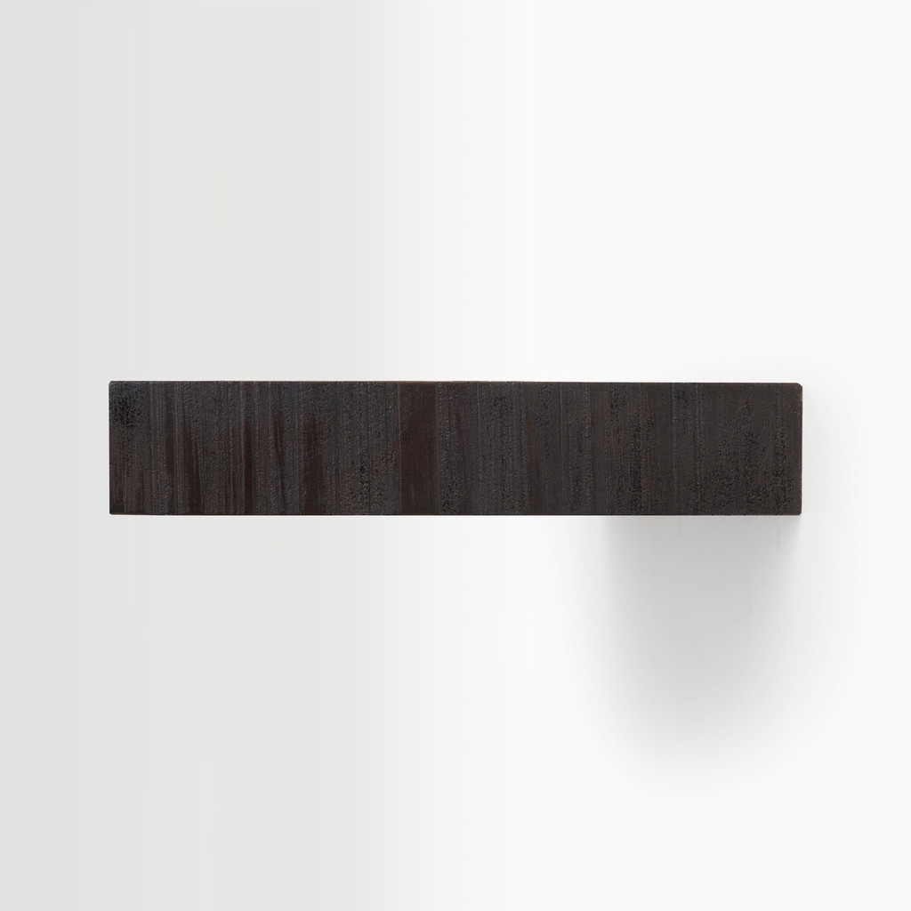 Side edge of our rough cut espresso floating wood shelves. The hardware is easy to install on most wall treatments and is completely invisible.