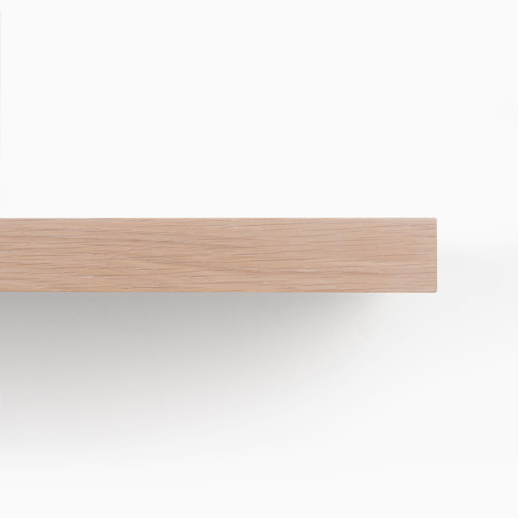 Front edge of our glaze finished white oak floating wood shelves.