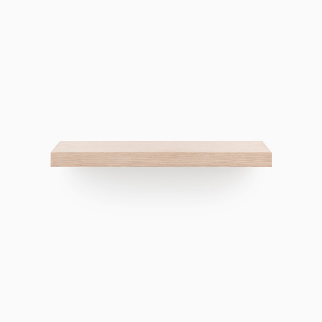Our glaze finished white oak floating woods shelves. Built to your specified length, includes a heavy duty floating shelf invisible hardware.