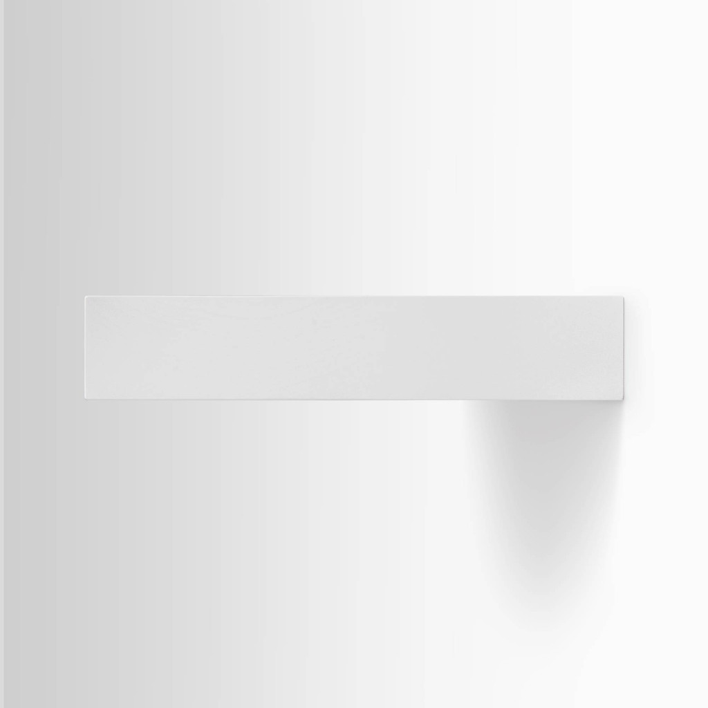 Side edge of our white painted floating wood shelves. The hardware is easy to install on most wall treatments and is completely invisible.