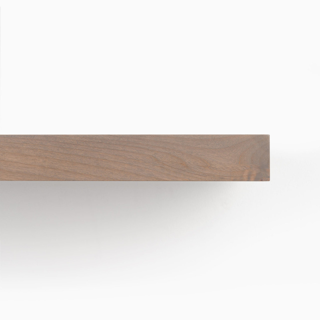 Front edge of our hatch grey solid alder floating shelf.