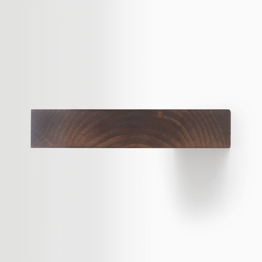 Side edge of our espresso finished alder floating wood shelves. The hardware is easy to install on most wall treatments and is completely invisibile.