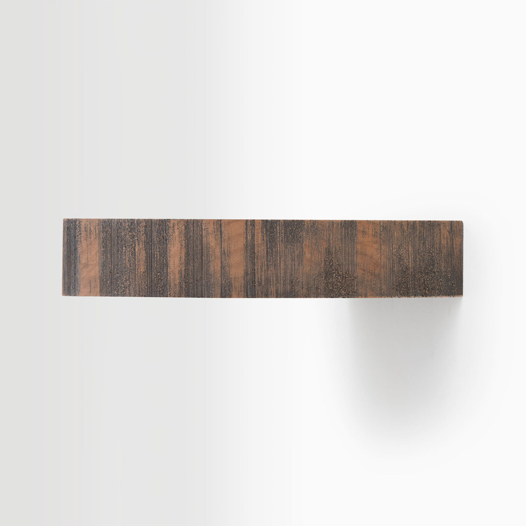 Side edge of our rough cut nutmeg floating wood shelves. The hardware is easy to install on most wall treatments and is completely invisible.