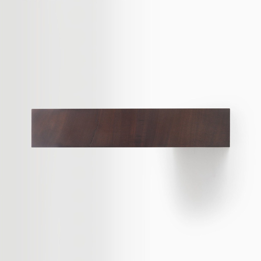 Side edge of our floating wood shelves. The hardware is easy to install on most wall treatments and is completely hidden in the shelf.
