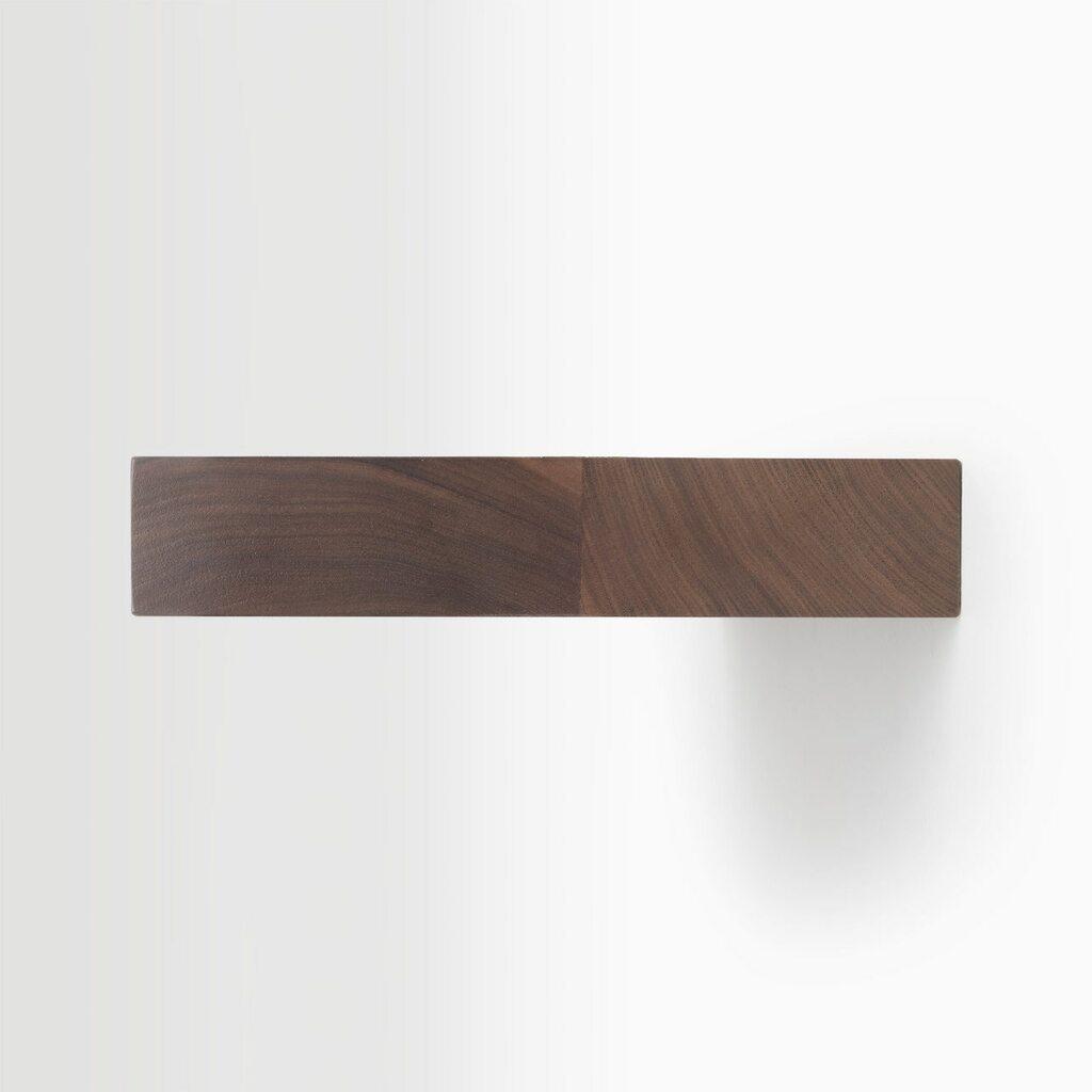 Side edge of our Walnut floating shelf kit. The hardware is easy to install on most wall treatments and is completely concealed in the shelf.