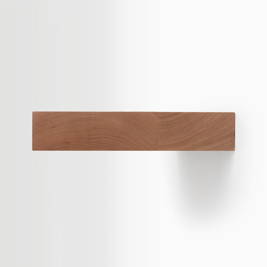 Side edge of our Cherry floating shelf kit. The hardware is easy to install on most wall treatments and is completely concealed in the shelf.