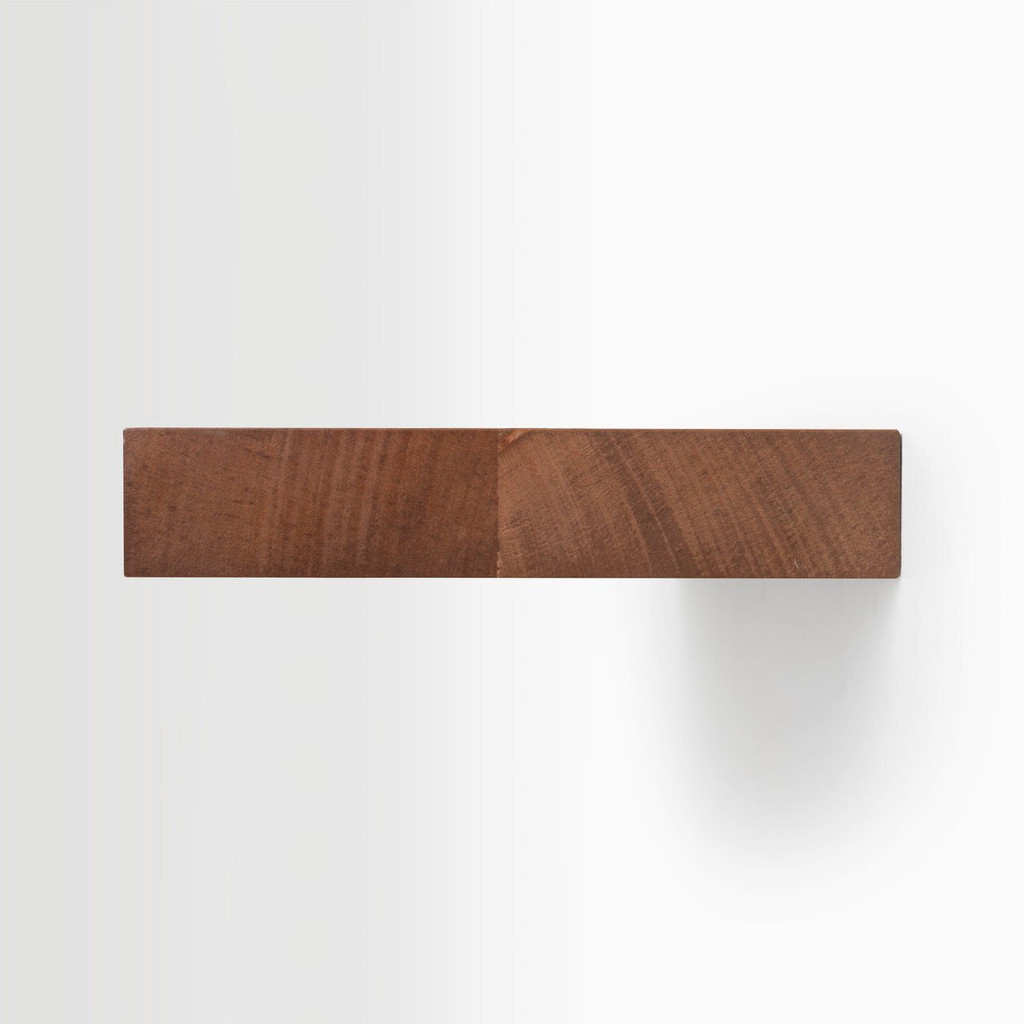 Side edge of our unfinished mahogany floating shelf. The hardware is easy to install on most wall treatments and is completely hidden in the shelf.