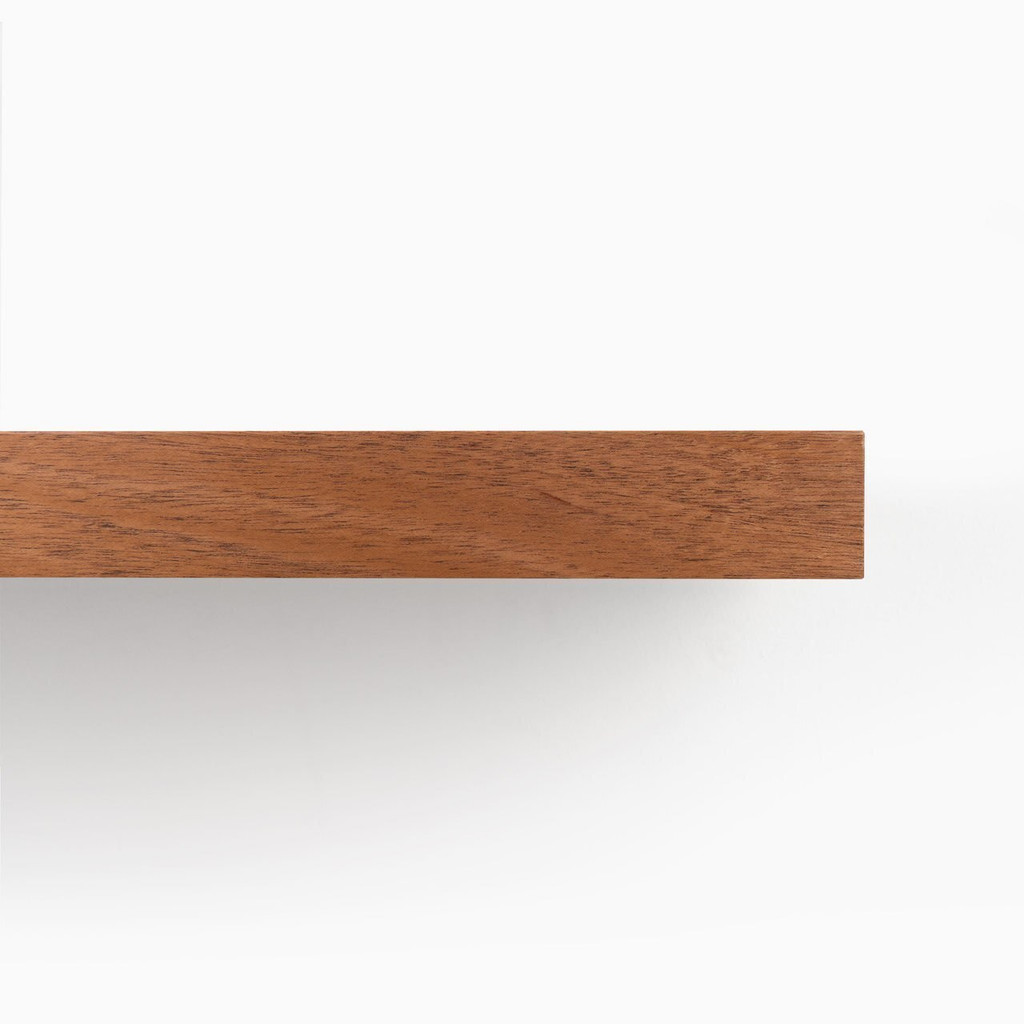Front edge of our Mahogany floating wood shelf. Perfect for any DYI'er or professional.