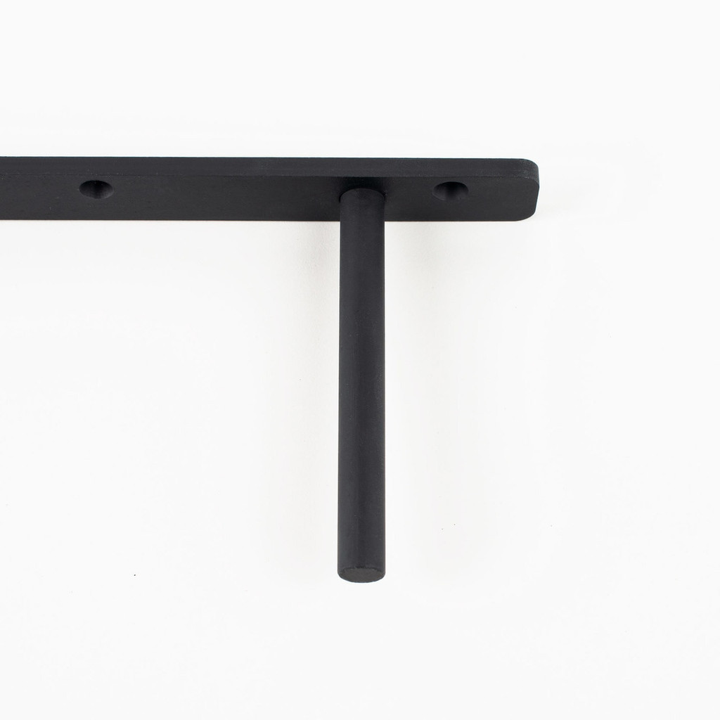 Detailed view of solid rod on our LD floating shelf bracket, constructed with 6 inch solid steel rods