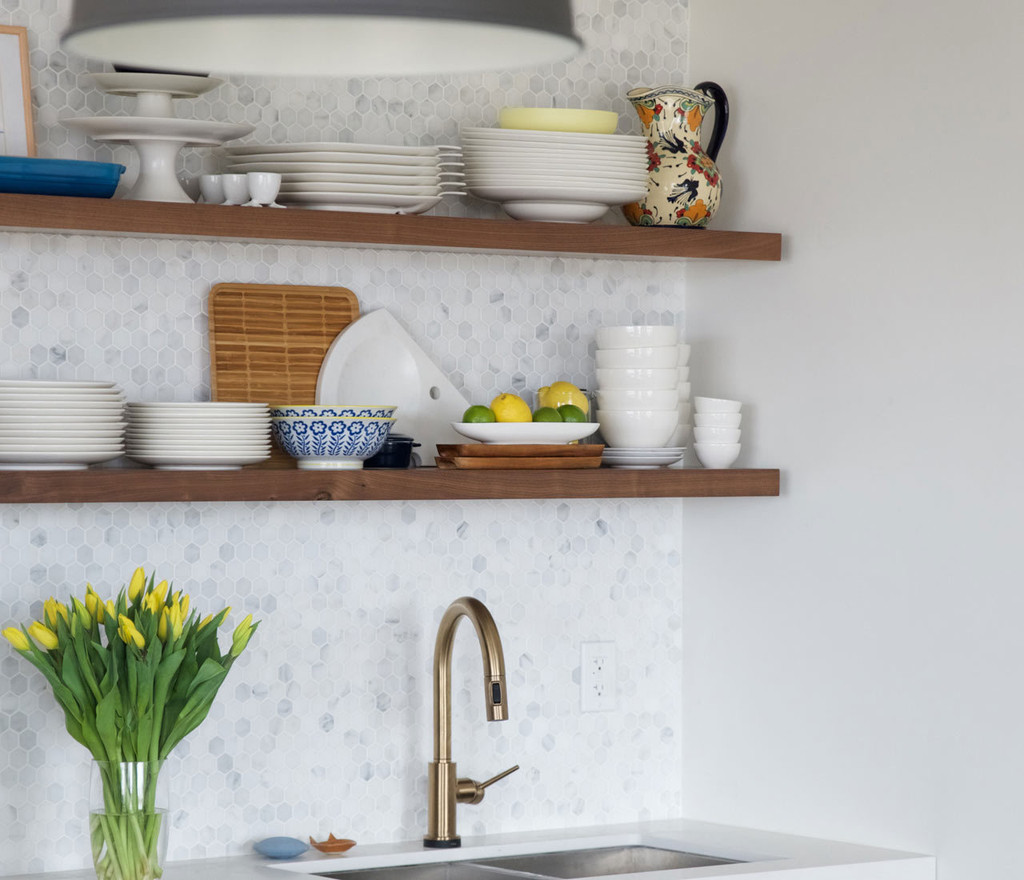 Two walnut floating shelves on a tiled kitchen wall above your sink