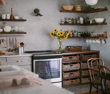 Several DIY floating shelves in a rustic kitchen setting
