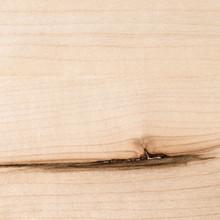 Clear satin finish on a maple shelf closeup