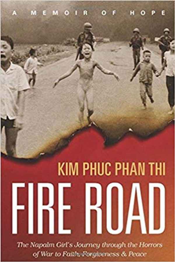 Fire Road: The Napalm Girl's Journey through the Horrors of War to Faith, Forgiveness, and Peace - SIGNED (Hardcover)