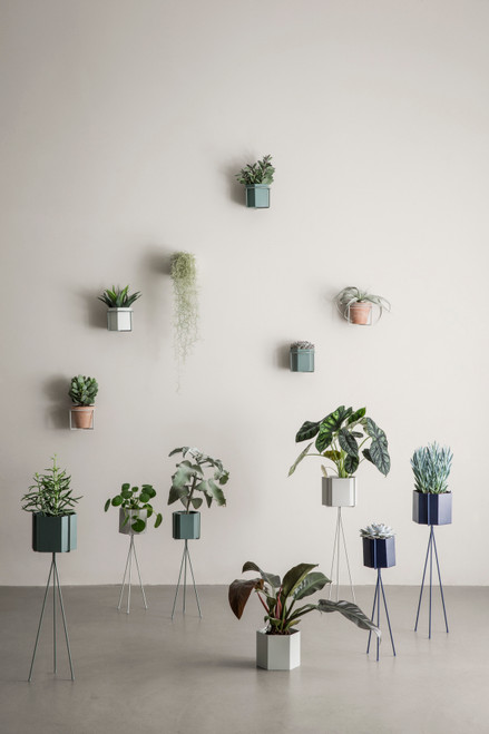ferm living hexagon pots on planter stands with legs