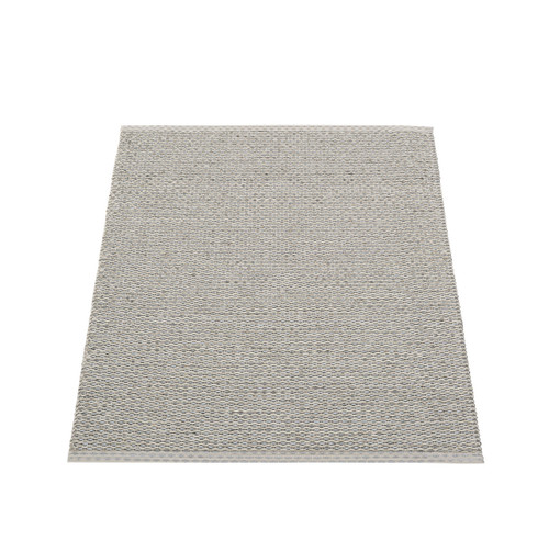 """Plastic rug for indoor and outdoor use, made in Sweden. Made of Swedish manufactured, certified phthalate free PVC ribbon, woven on traditional looms using wooden shuttles. Reinforced, welded edges for strength and durability. Very practical and easy-to-care-for, hand or machine wash at low temperature 30°C/85F, no spin. Measurements may vary ±4% due to the weaving process. Thickness 5 mm/0.2"""". Warm grey."""