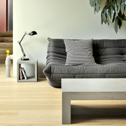 The Concrete Dawn Square Coffee Table is straightforward and modern.