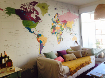 colorful map mural installed in room