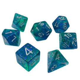 Translucent blue and green layered resin dice with big colorful chunks of glitter under silver-painted numbers