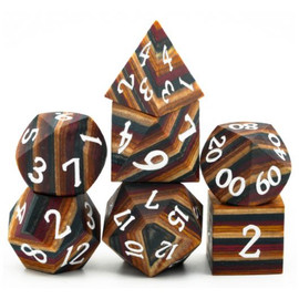 Brown striped wooden dice set with white painted numbers in a decorative tin
