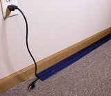 SAFCORD® - Designed to cover cables on carpet until manually removed.