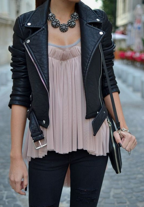 Black Pants, Dressy Blouse Paired With A Women's Motorcycle Jacket and Some Jewelry.