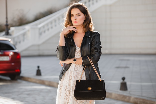 Woman Wearing A Leather Biker Jacket With A Stylish Handbag