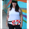 "This is the front of the Strong Skater fanny pack by Strong Athletic, made by Flat Track Revolution. This red fanny pack is made with a very durable water resistant fabric. Our hip bags have hand screen printed art- our Strong Athletic logo is printed in white ink and the words ""strong skater"" are printed in light blue ink. The zipper, adjustable nylon strap and the two-sided release buckle are black. The strap comes in two size options because bodies come in multiple size options."