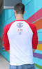 Back of the United Strong Athletes baseball t-shirt that was made in collaboration with USA Roller Derby team. This is a gender neutral Bella and Canvas t-shirt. The shirt is white and the ink is red and blue. 50 % of the profits gets donated to USA Roller Derby Use the tag #unitedstrongathletes when tagging us.