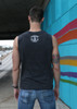 This is the back of the Strong Athletic Queer Muscle Tank for Any Body. The Strong Athletic logo is printed in white ink on the center of the shirt. This muscle tank is more conservative in that it doesn't show a ton of skin.