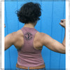 This is the Strong Athletic Grown-Ass Woman Crop Top Racerback Tank Top. The fabric of this crop tee-shirt is a mauve pink that has a rosy tone to it, the ink of the artwork is black. Crop top with design printed on the front. People love this crop top tank top because the arm holes are slightly larger than the average tank, giving it the muscle look that it's known for. We print this design on the Bella Canvas 6682 Crop Top Racerback Tank. All Bella shirts are made at a W.A.R.P. Certified facility.