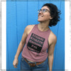 This is the Strong Athletic Grown-Ass Woman Crop Top Racerback Tank Top. The fabric of this crop tee-shirt is a mauve pink that has a rosy tone to it, the ink of the artwork is black. This makes for the perfect top ten gift for women who won't be silenced. Regardless of what you're speaking up about, Strong Athletic supports you and you inspire us to do more every day. We print this design on the Bella Canvas 6682 Crop Top Racerback Tank. All Bella shirts are made at a W.A.R.P. Certified facility.