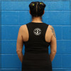 "This is the back view of the Strong Athletic Mom District Fitted Muscle Tank in Solid Black with White Ink. The arm holes for this tank are a bit ""dropped"" meaning that the opening for your arms is slightly larger than your average tank top.  If you wear a bra, a binder or a smaller tank under this design, it'll be visible. For many people this is why they love this tank so much- they can show off their favorite bra. The Strong Athletic logo is printed in white ink on the back of the tank in the center of the shoulders. Strong Athletic is a feminist woman and mom owned company that believes that there should be space for moms within sports and athletics. Having a child shouldn't mean that your sports participation ends."